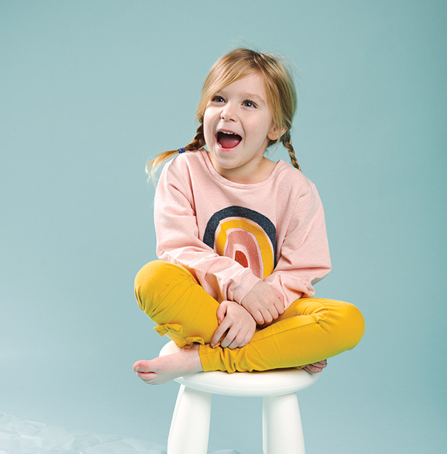A child models clothing from Oh Baby!