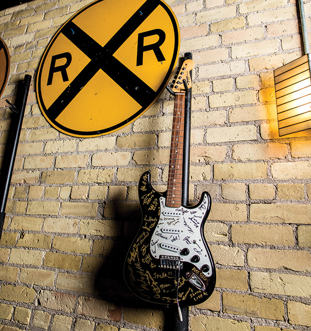 A guitar hangs on the wall at The Freight Room (formerly known as The Depot).