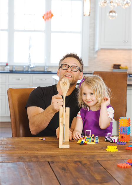 Steve Kuhl plays with his daughter.