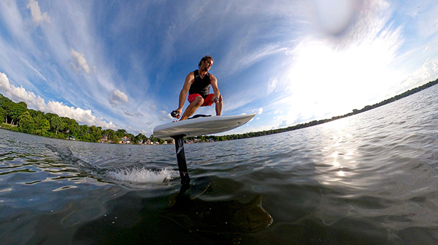 A man surfs on Lake Minnetonka